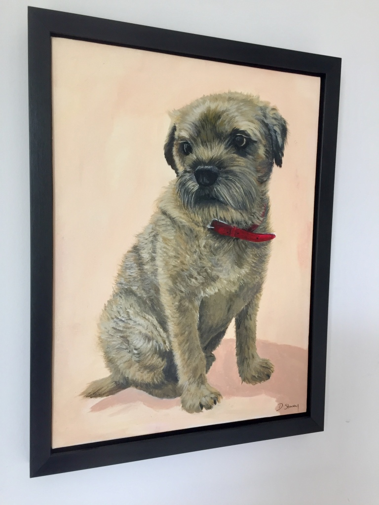 Framed painting of a border terrier